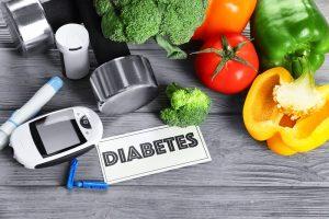 Hantel, Gemüse sowie eine Insulinspritze